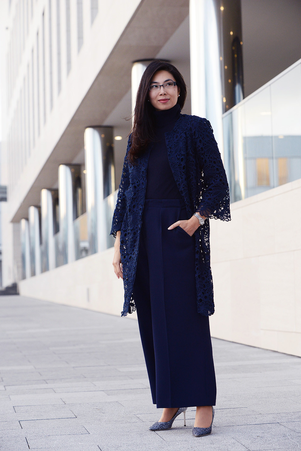 Business Casual woman outfit styled with navy wide leg pants from Roland Mouret.
