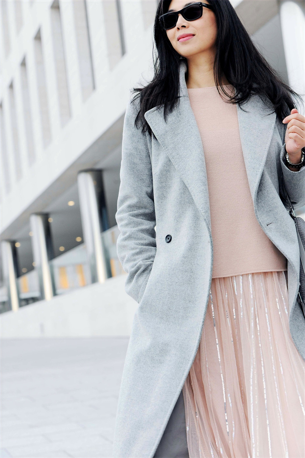 Business casual woman outfit with Needle & Thread rose quartz tulle skirt and light grey Karen Millen wool coat.