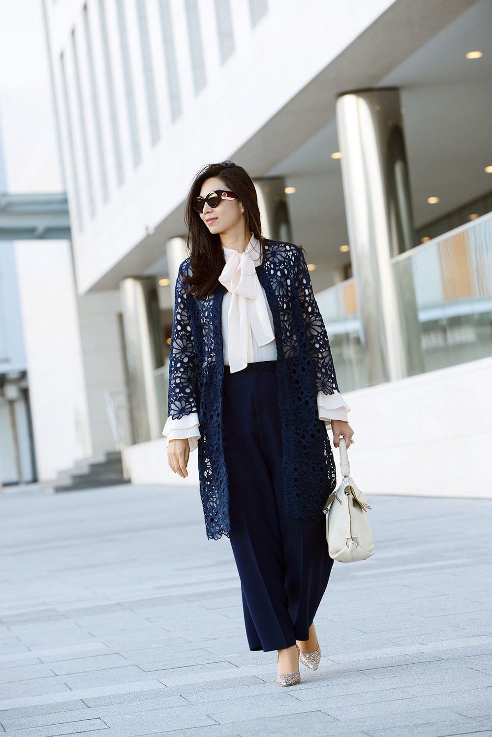Gerard Darel navy lace coat styled with Roland Mouret navy pants and a blush pussy bow blouse.