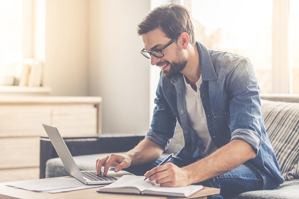 man on laptop researching
