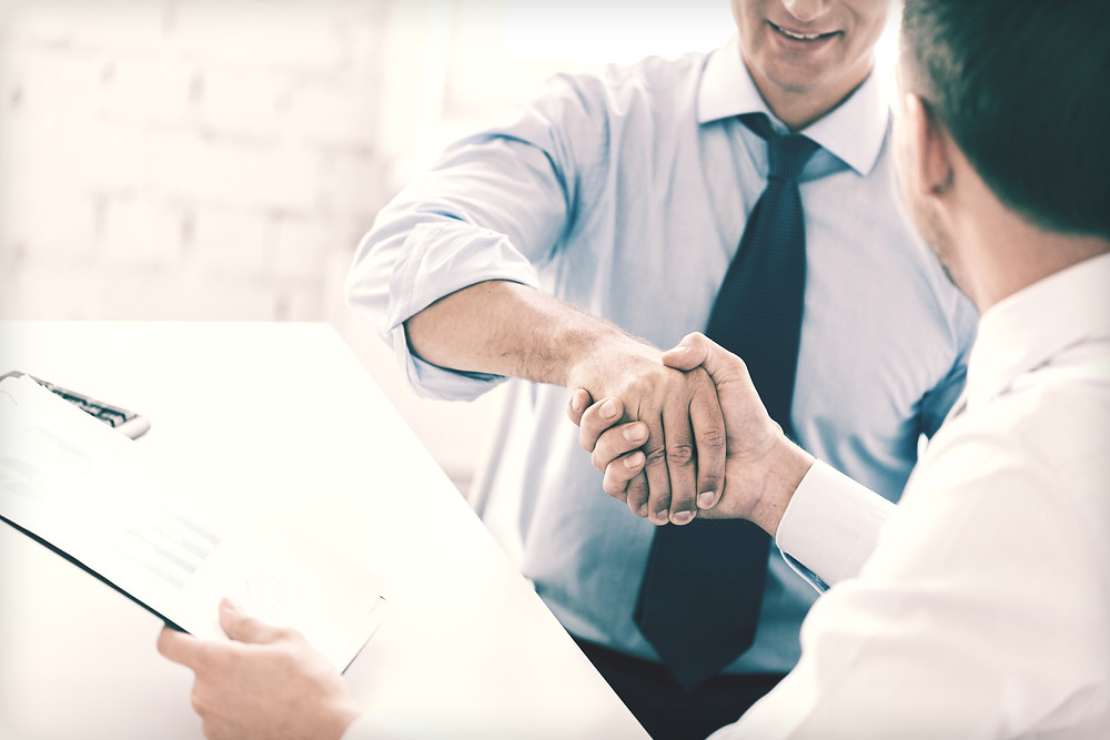 commercial business loans hand shake