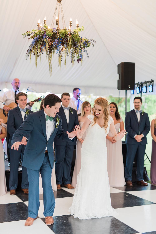 bride groom dance tent flowers