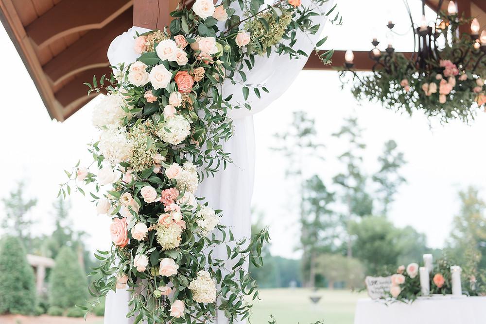 wedding coordinator flowers arbor ceremony