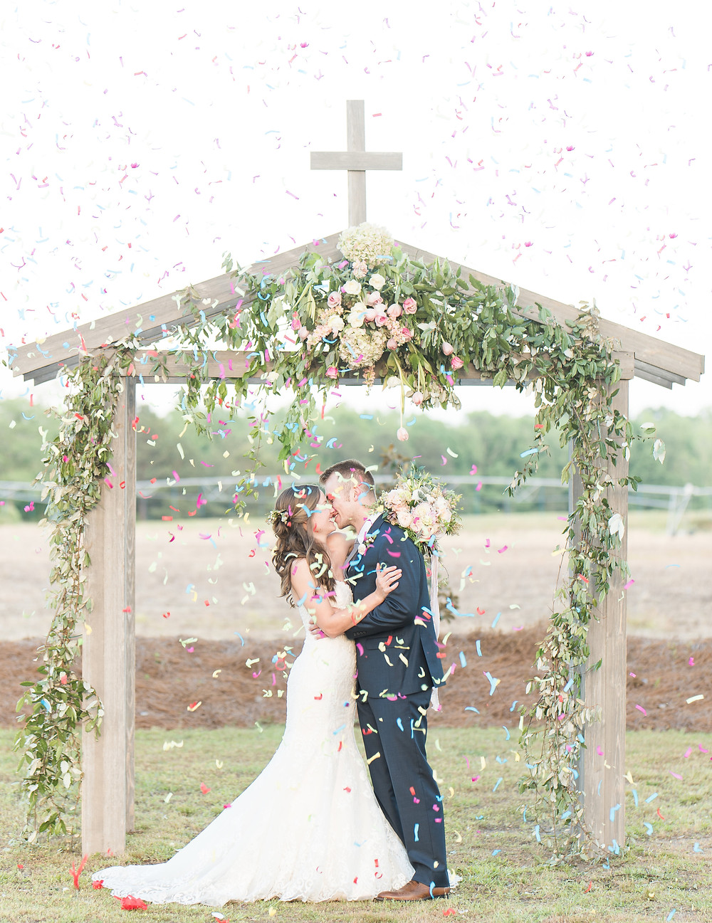auburn wedding  ceremony kiss arbor florist