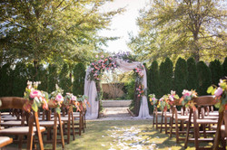 southern ceremony arbor with florals