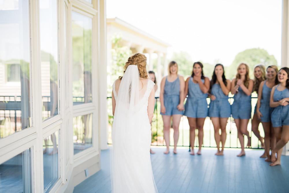 bride bridesmaids first look