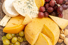 close-up-rustic-cheese-with-grapes.jpg