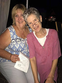 Happy poem recipient Janie Clark and poet Karen Hayes at the White Street Walk Poetry on Demand tenf ro the Writers' Colony at Dairy Hollow