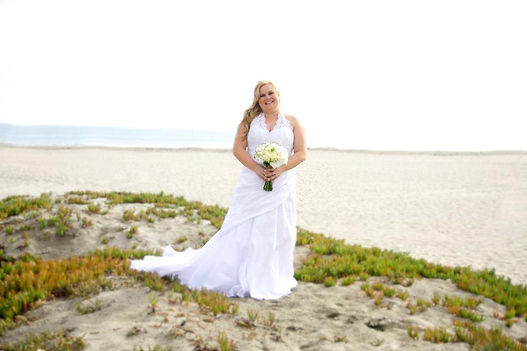 bride wedding day pose beach