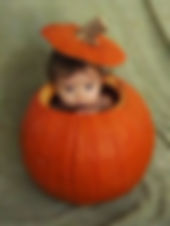 baby in a pumpkin for halloween