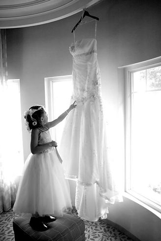 flower girl pose with wedding dress