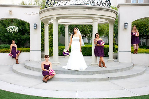 bride and bridesmaids pose wedding photo