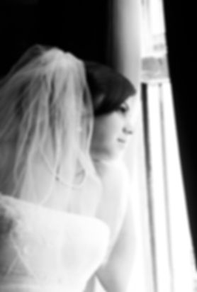 bride looks out window pose wedding