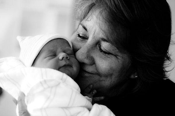 Grandma holding newborn baby just after hospital birth