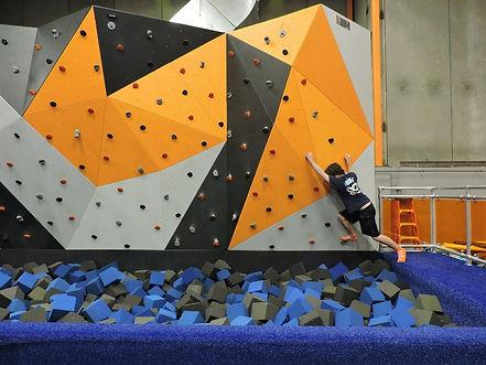 student rock climbing during fun fridays