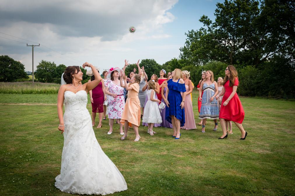Bride throwing boquet