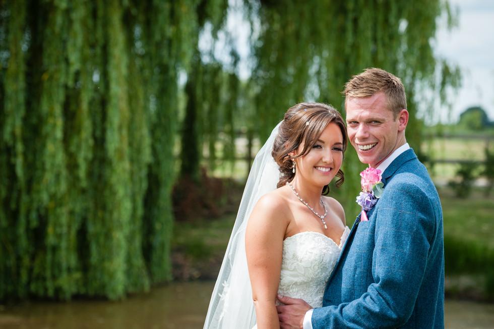 groom and bride at lake