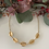 Thumbnail: Gold Cowrie Shell Necklace