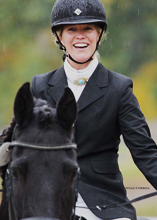 Sandra Ierardi on Onyx smiling through the rain.jpg