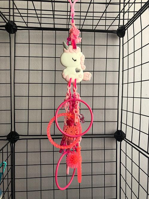 Juguete unicornio rosa de goma