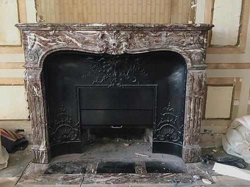 Cheminée ancienne de style LOUIS XV en marbre Rance.