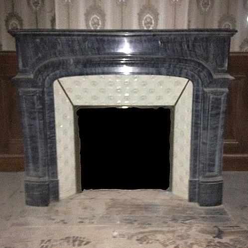 Cheminée ancienne de style LOUIS XIV en marbre bleu turquin.