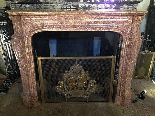 Cheminée ancienne de style LOUIS XV en marbre brocatelle rose et jaune.