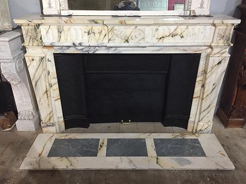 Trés Grande Cheminée ancienne de style LOUIS XVI en marbre Paonazzo.