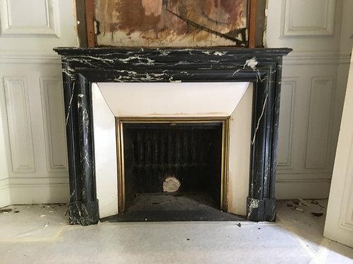 Cheminée ancienne de style LOUIS XIV en marbre marquina.