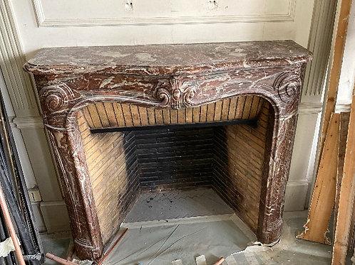 Cheminée ancienne de style LOUIS XIV en marbre rouge rance.