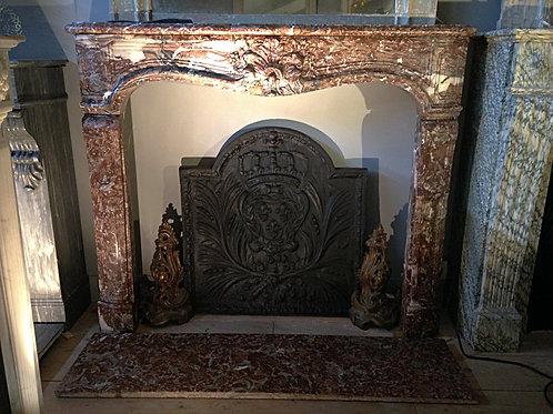 Cheminée ancienne  LOUIS XV en marbre rouge rance.