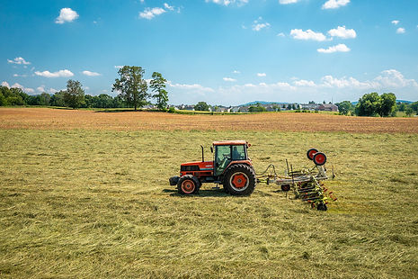 Tractor raking hay.  Image by Edwin Remsberg