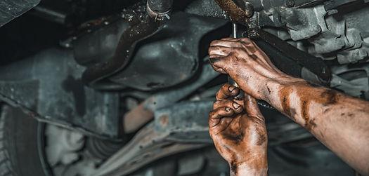 hands-of-worker-at-car-repair-service2.j