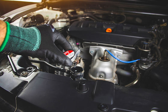 mechanics-man-is-opening-radiator-cap-of