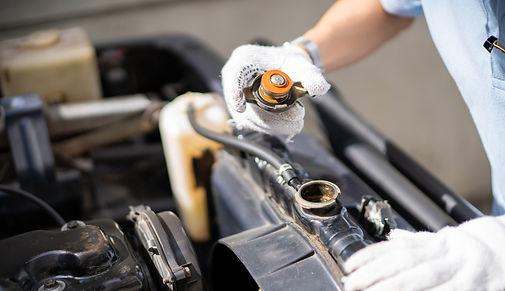car-repair-man-checking-the-coolant-syst