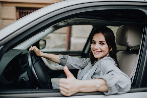 young-woman-sitting-in-the-car-and-showi