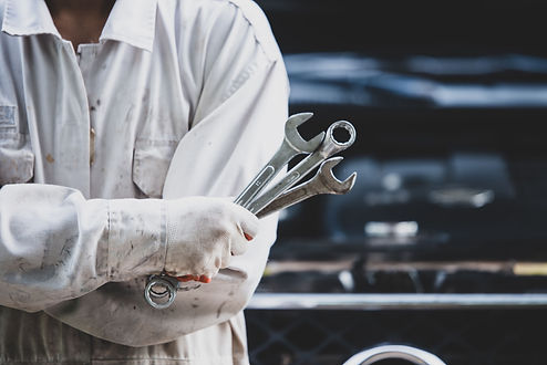 car-repairman-wearing-white-uniform-stan