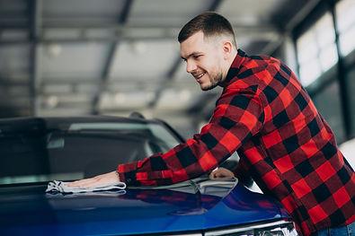 young-man-polishing-his-car-with-rag.jpg