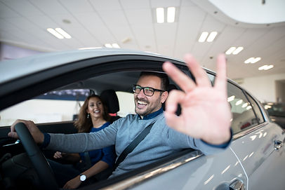 happy-customer-buying-new-car-at-dealers