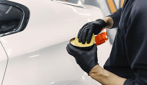 man-polish-car-in-garage 2.jpg