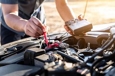 man-checking-the-battery-of-car2.jpg