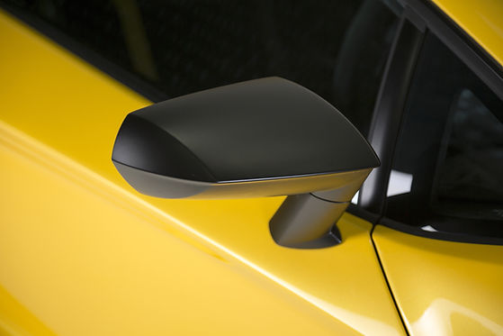 closeup-shot-of-the-black-side-mirror-of