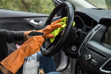 female-hand-cleaning-her-car-interior-fr