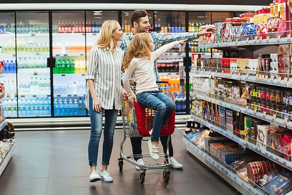 cheery-little-girl-sitting-on-shopping-c