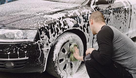 handsomen-man-in-black-sweater-washing-h