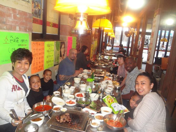 Family eating Korean food