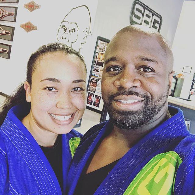 A married couple training Brazilian Jiu-Jitsu