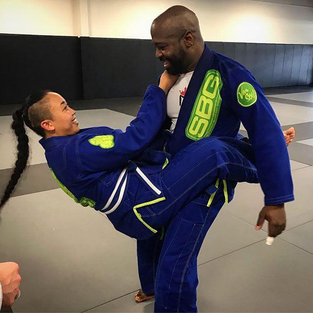 Married couple training Brazilian jiu-jitsu
