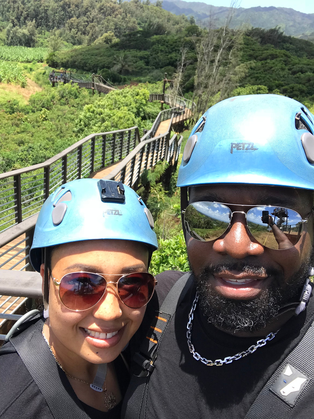 Married interracial couple zip-lining in Oahu, Hawaii