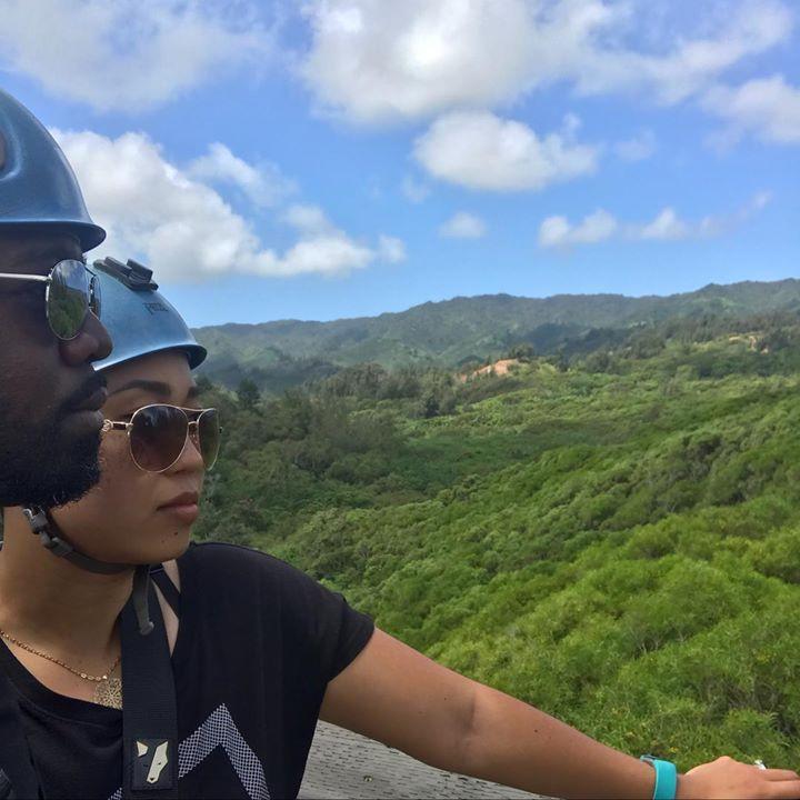 Interracial married couple zipping in Oahu Hawaii